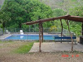 Las Juntas approximately 1.500 m2 plot, with a simple wooden house, a large swimming pool