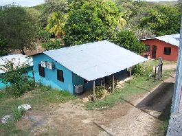Land for sale with 4 houses in Tamarindo / Guanacaste / Villareal