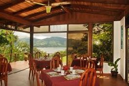 For sale, beautiful lodge with view on the Arenal Lake, a beautiful landscaped garden with many species in Nuevo Arenal