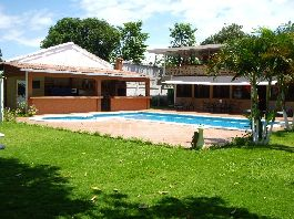 Costa Rica real estate for sale, house, 2 apartments, swimming pool, tropical garden with direct beach access