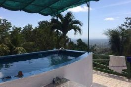 House with 2 large 165 m2 apartments, pool, 4.500 m2 garden at Parrita for sale