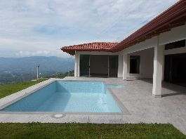 For sale, new house with fantastic views, swimming pool, terrace, sun deck and a tropical garden, near Atenas