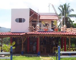 House with restaurant right on the beach for sale