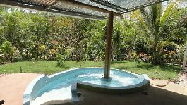 For sale, house with Jacuzzi  and tropical garden, at Ostional