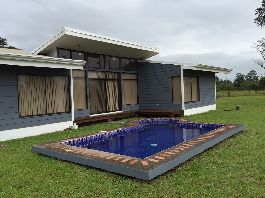 Buy house and lot with pool in Sarapiqui